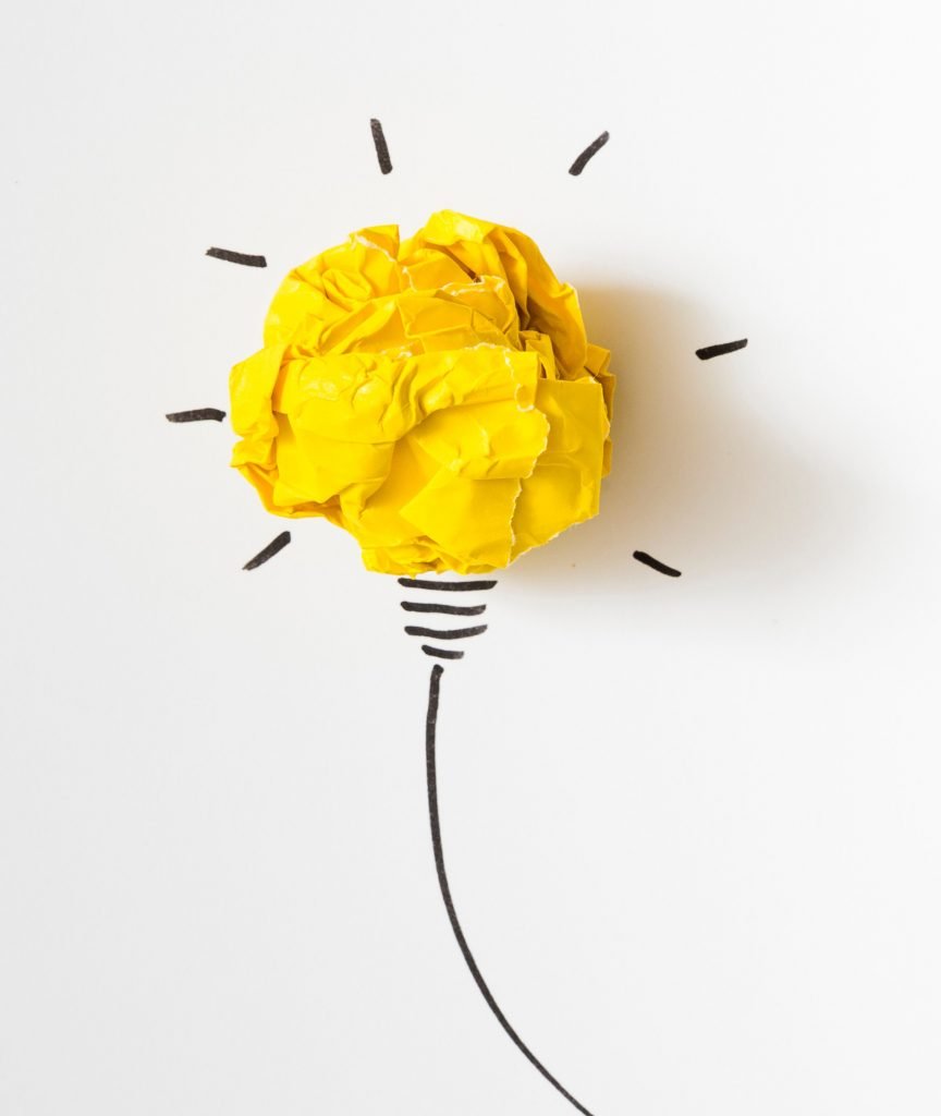 Image shows illuminated lightbulb with crumpled yellow paper used in the bulb's place and the rest drawn in black on a white background.