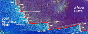 Figure 1.2.6: A part of the mid-Atlantic ridge near the equator. The double white lines are spreading ridges. The solid white lines are fracture zones. As shown by the yellow arrows, the relative motion of the plates on either side of the fracture zones can be similar (arrows pointing the same direction) or opposite (arrows pointing opposite directions). Transform faults (red lines) are in between the ridge segments, where the yellow arrows point in opposite directions.