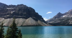 Figure 5.1.2: An area with very effective frost-wedging along glacial-fed Bow Lake in Banff National Park. The fragments that have been wedged away from the cliffs above have accumulated in a talus deposit at the base of the slope.
