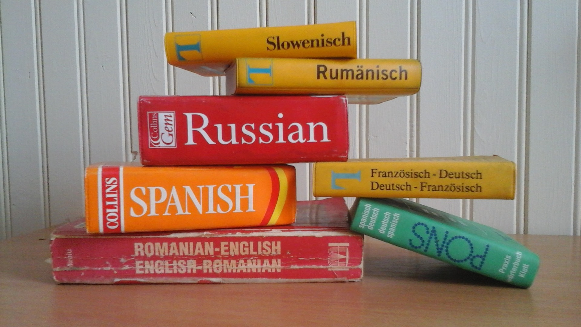 stack of various dictionaries