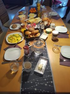 breakfast table with all types of cheese, sausage, bread, etc